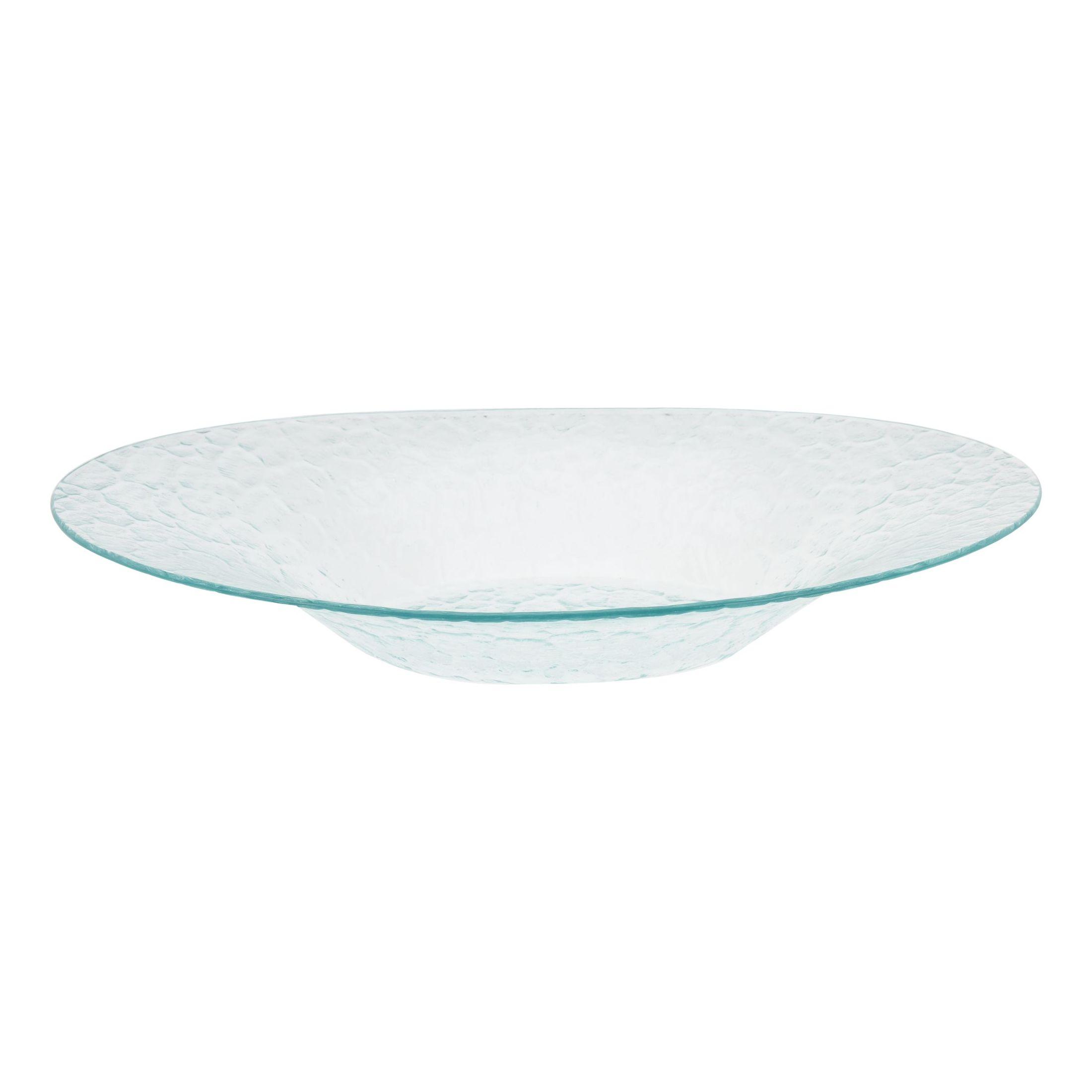 Тарелка сервировочнаяЭта сервировочная тарелка подойдет для оформления повседневного или праздничного стола. Модель характеризуется вместительностью, а за счет широких бортиков содержимое тарелки не прольется на стол. Изделие легко моется и изготавливается из прочного прозрачного стекла – материала, безопасного для людей и окружающей среды.Модель украшает стильный узор, который впишется в интерьер каждой кухни и подойдет к имеющемуся комплекту посуды. Сервировочная тарелка Excellent Houseware популярна среди покупателей и получила немало положительных отзывов.<br>
