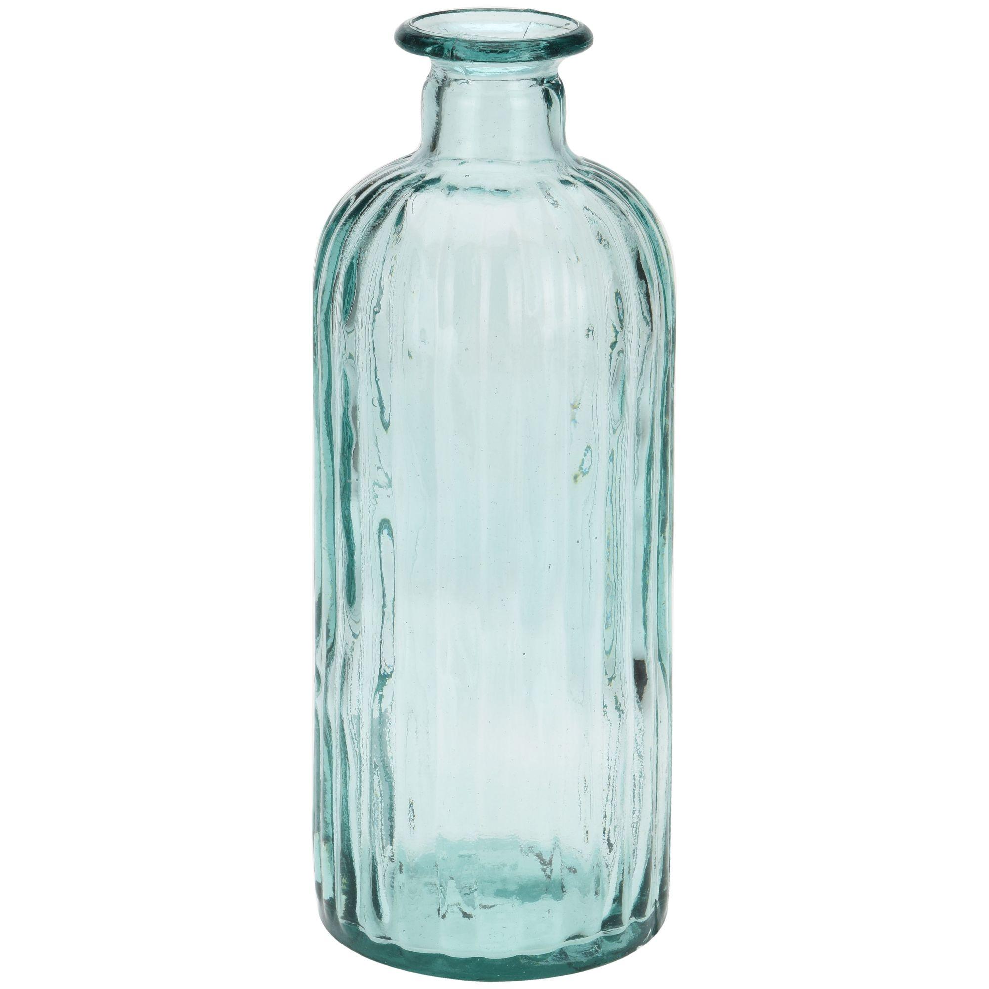 ВазаВаза h28 см Бутылка «стекло» сделает интерьер помещения интересным и оригинальным. Форма изделия – вытянутая в высоту бутылка с узким горлышком. Края вазы гладкие, несмотря на использование стекла они не дадут возможности пораниться. Модель полностью прозрачная, поэтому стебли поставленных цветов будут видны. Габариты декоративной вазы оптимальны для настольного варианта. Модель не выглядит хрупкой, в ее хорошей устойчивости на плоскости не приходится сомневаться. Ваза бренда Экселент Хаусвейр сделана качественно, простой с виду дизайн будет смотреться уместно наряду с другими предметами мебели. Любая хозяйка захочет получить такой подарок, чтобы пополнить коллекцию оригинально оформленной вазой.<br>